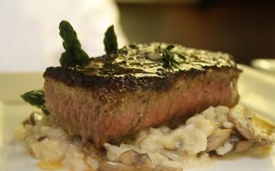NY Strip steak over mushroom risotto.