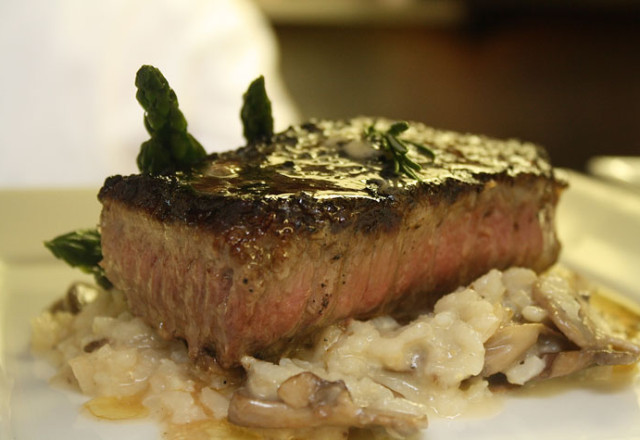NY Strip steak over mushroom risotto.