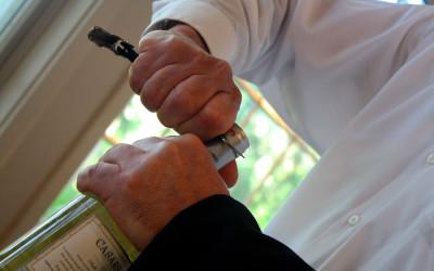waiter opening a bottle of wine