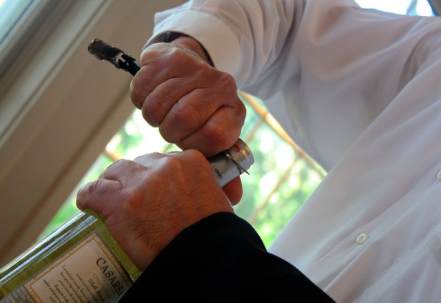 waiter opening a bottle of wine